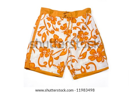 Orange floral pattern swimming trunks isolated on white. - stock photo