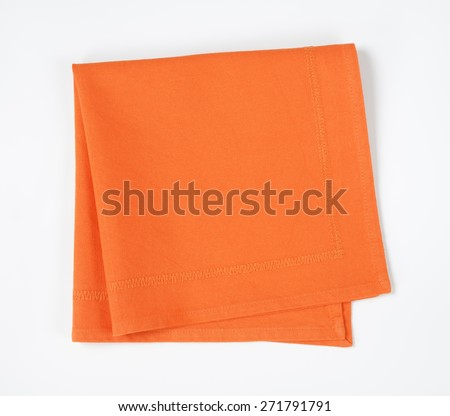 Orange folded napkin on white background