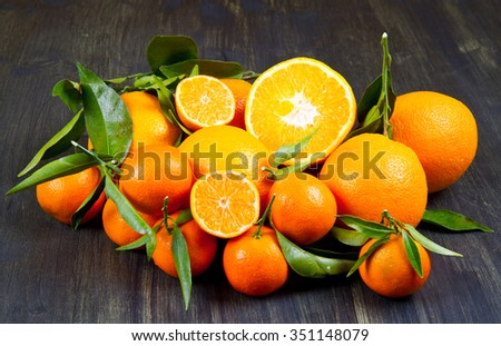 orange fruit and fresh tangerines oranges on wood - stock photo
