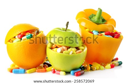 Orange fruit, apple and bell-pepper and colorful pills, isolated on white - stock photo