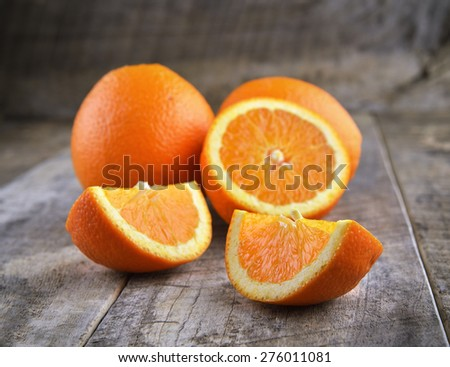 Orange fruit  on brown wooden background - stock photo