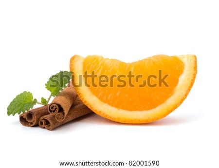 Orange fruit segment, cinnamon sticks and mint isolated on white background. Hot drinks ingredients. - stock photo