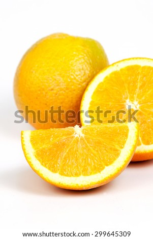 Orange fruit split on white background