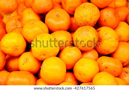 Orange fruits at Fruit Shop or greengrocery on street for sale at market in Luang Prabang, Laos - stock photo