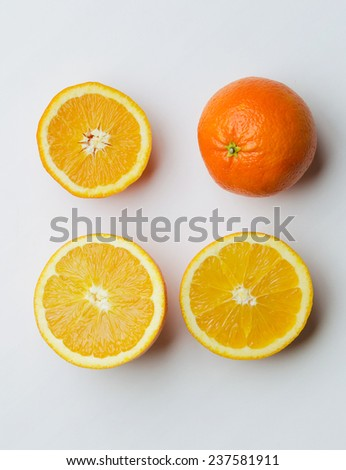 Orange fruits over white table, above view - stock photo