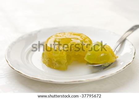 orange gelatin dessert with grape - stock photo