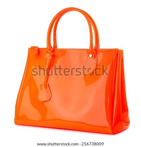 Orange glossy female handbag isolated on white background. - stock photo