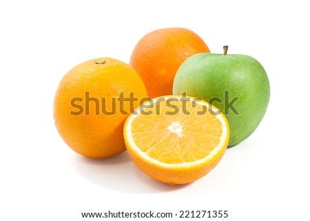 Orange  green apple on white background - stock photo