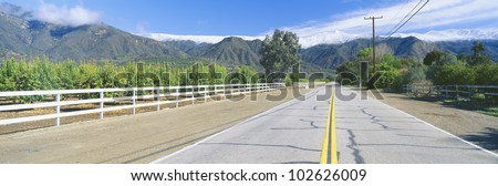 Orange Groves & Snow on Topa Topa Mountains, Ojai, California - stock photo