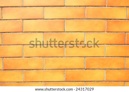 Orange grunge brick wall background. - stock photo