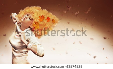 Orange haired beauty on studio background - stock photo