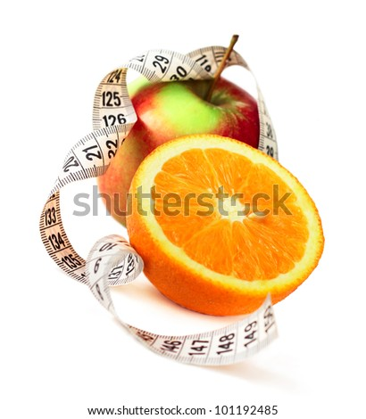 Orange half  apple and measure tape diet concept isolated on white corner composition - stock photo