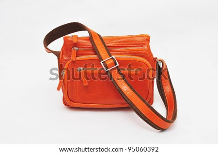 Orange hand bag isolated on white background