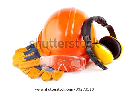 Orange hard hat, earphones, goggles and gloves on a white background - stock photo