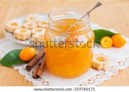 Orange homemade jam marmelade in a glass jar - stock photo