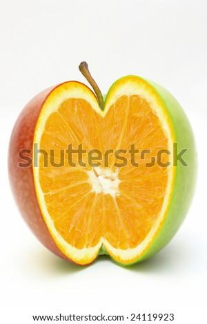 Orange in apple - stock photo