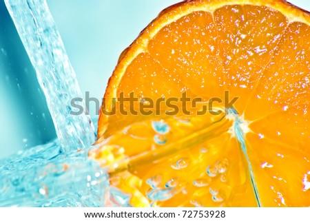Orange in water splash - stock photo