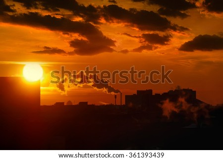 orange industrial sunset with clouds and smoke in city, Ukraine
