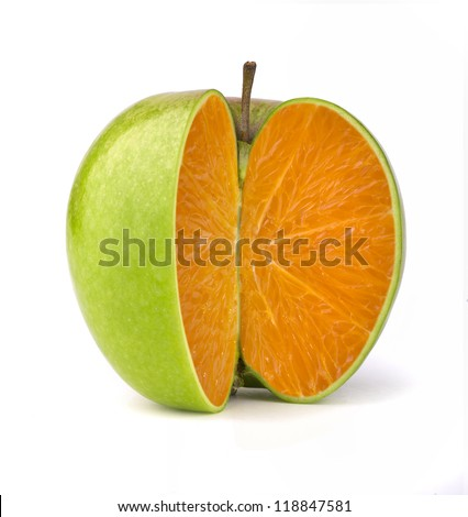 Orange inside a green apple - stock photo