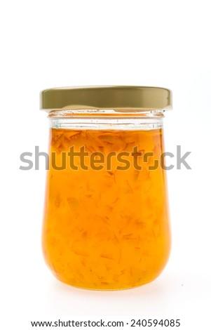 Orange jam jar isolated on white background - stock photo