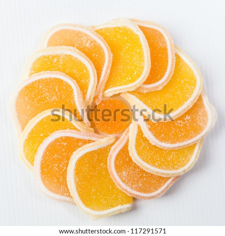 Orange  jelly candy arranged in a circular pattern