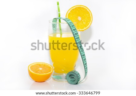 Orange juice and measuring tape. Diet concept - stock photo