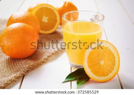 Orange Juice and orange fruit on white table - stock photo