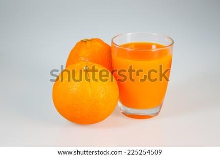 Orange juice and orange isolated on white - stock photo