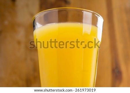Orange juice and oranges - stock photo