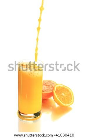 Orange juice and oranges on a white background - stock photo
