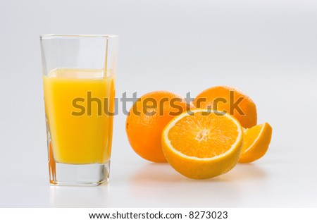 Orange juice and oranges on white background