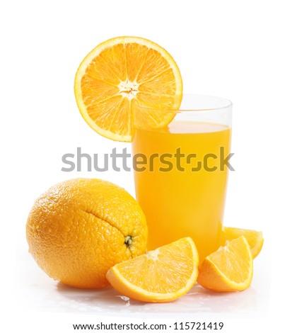 Orange juice and slices isolated on white - stock photo