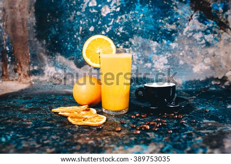 Orange juice and strong espresso served as breakfast in pub, restaurant - stock photo