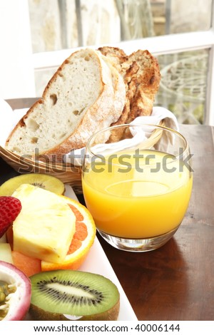 Orange Juice Cup with a Breakfast Meal