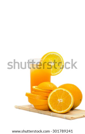 Orange juice in a glass with ice closeup isolated on white - stock photo
