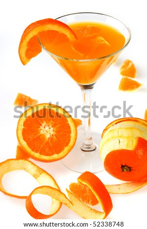 Orange juice in cocktail glass isolated on white background