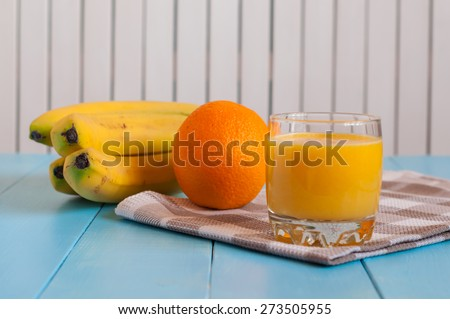Orange juice in glass, fresh fruits on wooden background. healthy food, diet and detoxification - stock photo