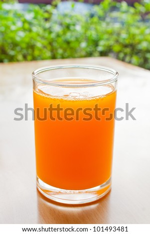 Orange juice in glass on the table - stock photo