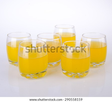 Orange juice in glasses on the background