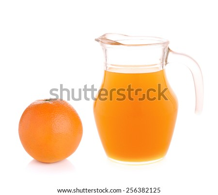 Orange juice in pitcher with orange. Isolated on white background - stock photo