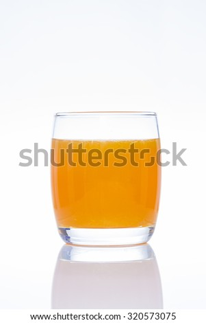 Orange juice in the glass isolated on a white background, clipping path included - stock photo