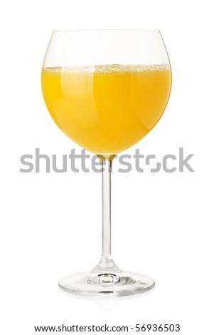 Orange juice in wine glass. Isolated on white background - stock photo