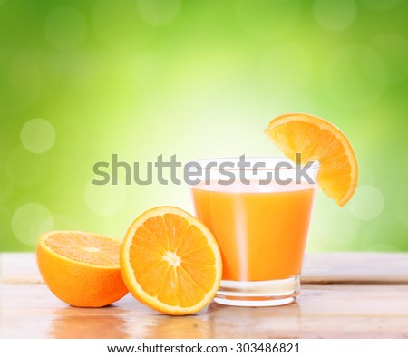 Orange juice on a wood - stock photo