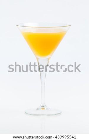 Orange juice on cocktail glass on white background - stock photo