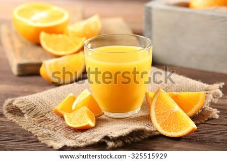 Orange juice on table close-up - stock photo