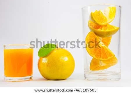 Orange juice, orange in the glass.