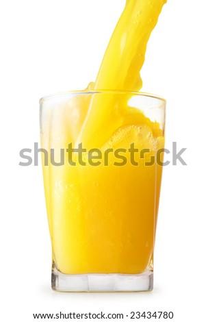 orange juice pored in glass - stock photo