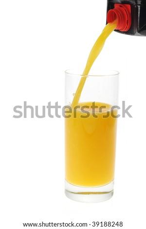 orange juice pour into glass - stock photo