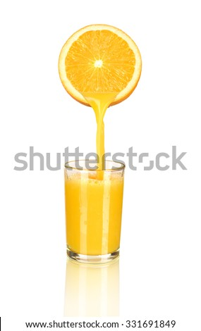 orange juice pouring in glass from half of orange isolated on white - stock photo