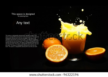 Orange juice splash on black background - stock photo